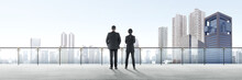 Rear View Of Two Asian Business People Standing On Modern Terrace And Looking At View