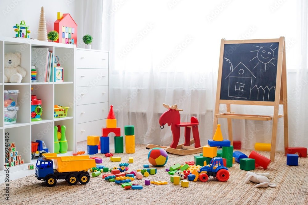Fototapety, obrazy: Children's playroom with plastic colorful educational blocks toys.