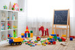 canvas print picture - Children's playroom with plastic colorful educational blocks toys.