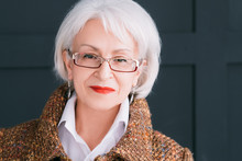 Senior Fashion Model Portrait. Modern Lifestyle. Stylish Aged Woman In Autumn Outfit Looking At Camera.