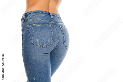 Pretty female ass in jeans on white background Canvas Print