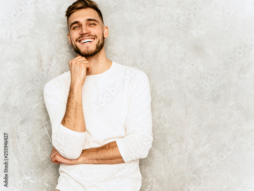 Photographie  Portrait of handsome smiling hipster lumbersexual businessman model wearing casual summer white clothes