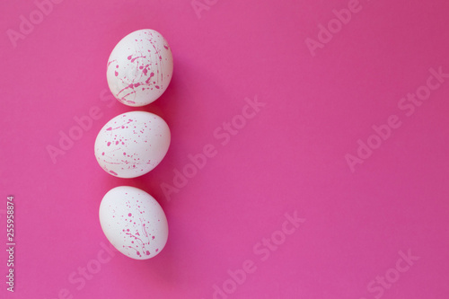 Papiers peints Rose Beautiful Easter composition with coloredd eggs in white and pink on pink background. Spring holidays Easter backdrop Invitation