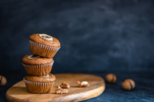 Stack Of Homemade Delicious Muffin On Dark Background. Cup Cakes With Banana And Walnut. Side View, Copy Space