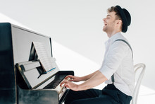 Excited Pianist In Stylish Clo...