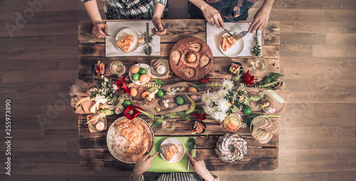 Foto op Canvas Kruidenierswinkel Apartment-feast of friends or family at the festive table with rabbit meat, vegetables, pies, eggs, top view.