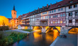 Leinwanddruck Bild Historic city center of Erfurt with famous Krämerbrücke bridge illuminated at twilight, Thüringen, Germany
