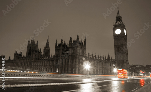 Snow covered Westminster Palace at dawn over dark grey sky #255984852