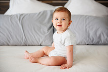 Portrait Of Charming Baby Girl On The Bed