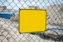 Empty Yellow Sign On Construction Site Fence - Warning Sign Mock-up,