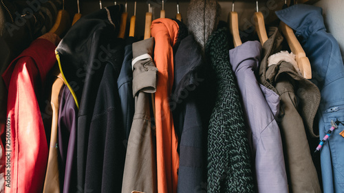 Obraz overcoats on hangers - fototapety do salonu
