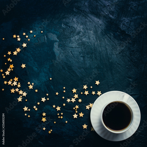 Recess Fitting Tea Cup of coffee and stars on a dark blue background. Concept of the Starry sky and Coffee. Flat lay, top view
