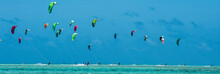 People Practicing Kitesurfing ...