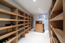 Wine Cellar With Bottles And Cigar Humidifier