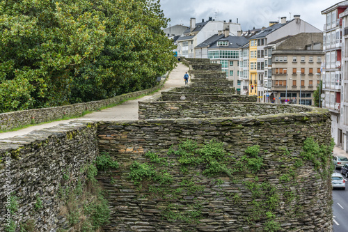 Fotografie, Obraz  The Roman wall of Lugo surrounds the historic center of the Galician city of Lug