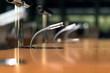 Leinwandbild Motiv Mikrofon auf einem Tisch in einem Konferenzsaal – extrem viel Tiefenunschärfe für ausreichend Copyspace