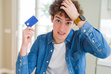 Young Man Holding Credit Card ...