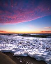 Sea Waves Under Orange And Blue Skies