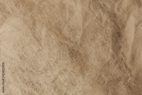 Brown textured flat paper with natural geometric shape.