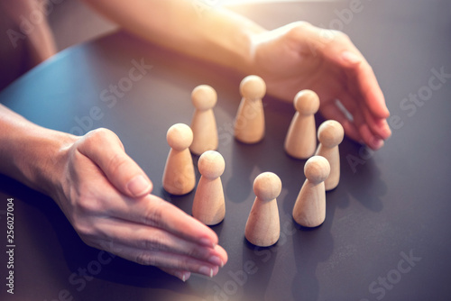 Foto  Woman hands defending his team with a gesture of protection, Security and safety in a business team