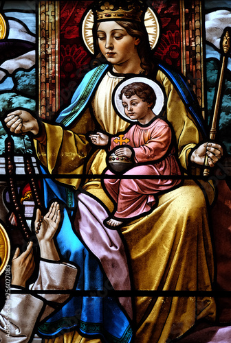 Spoed Foto op Canvas Stained Virgin Mary with baby Jesus, stained glass window in the Parish Church of the Visitation of the Virgin Mary in Zagreb, Croatia