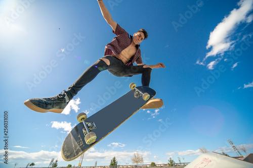 Fotografie, Obraz  skater with skateboard doing trick the air