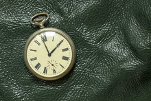Old Pocket Watches Lie On A Gr...
