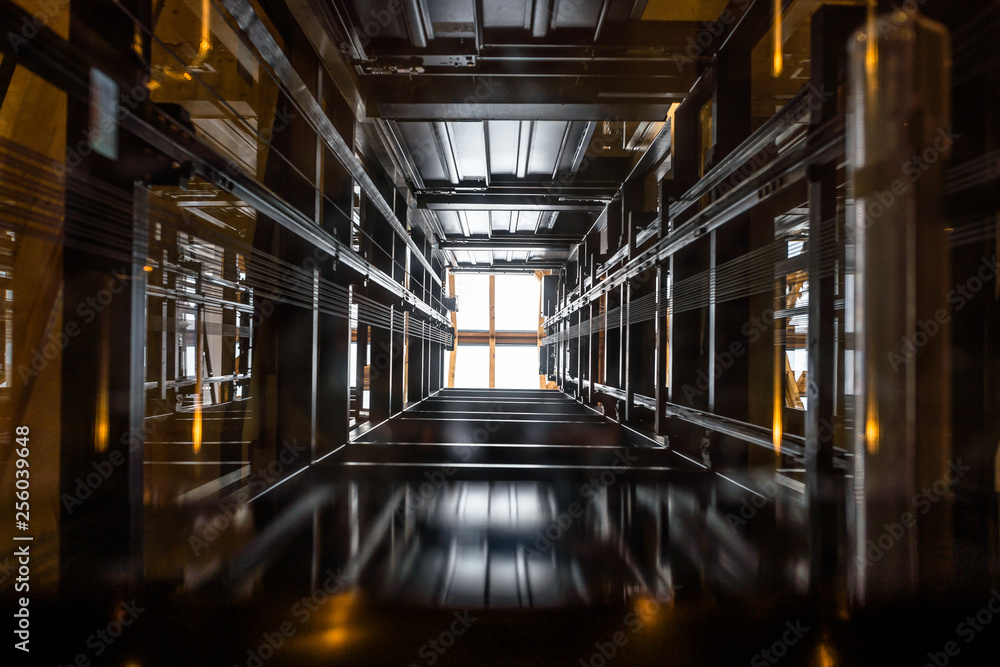 Fototapety, obrazy: The passenger lift shaft seen from the glass cabin, a glazed roof at the top.