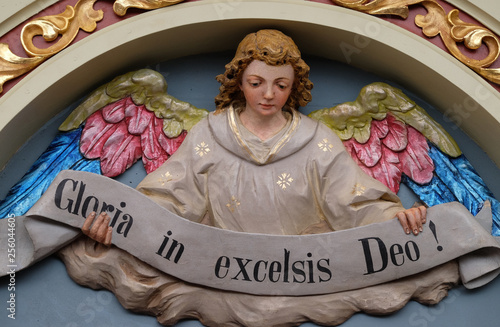 Photo Angel with Gloria in excelsis Deo Banner, Nativity Scene, altarpiece in the chur