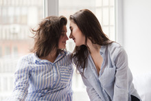 Two Girls Same Sex Going To Kiss On Window Sell