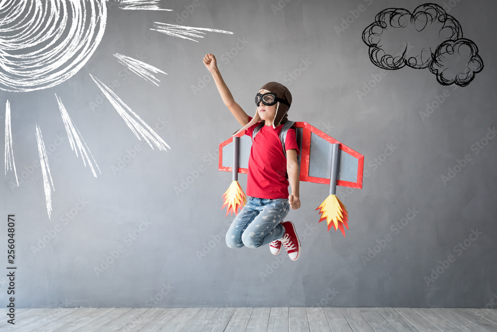 Fototapety, obrazy: Happy child playing with toy jetpack