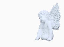 Statue Of  Little Angel As Sym...