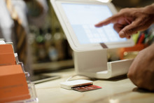 Hand Points At Screen During Payment Transaction