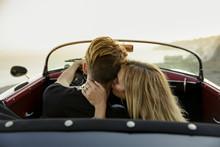 Young Woman Kisses Man's Neck ...