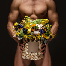 Sexy Man Holding Box Of Mix Flowers In His Hands For Beloved Woman As A Gift. Romantic Date.