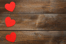 Red Hearts On Brown Wooden Background
