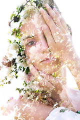 Panel Szklany Eko Double exposure portrait of a naturally beautiful woman partially hiding her face combined with stunning pure white flower petals