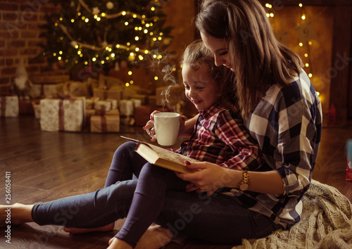 Printed kitchen splashbacks Artist KB Mother reading a book for her daughter in a calm, winter eveneing