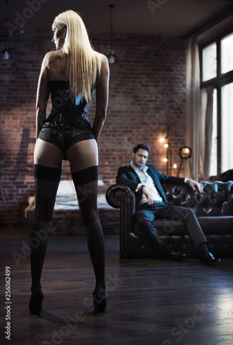 Foto auf Leinwand Artist KB Handsome businessman looking at the sensual woman