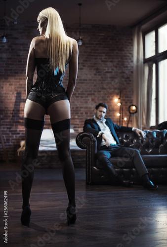 Fotobehang Artist KB Handsome businessman looking at the sensual woman