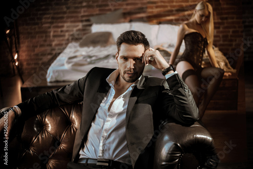Montage in der Fensternische Artist KB Handsome man relaxing in the luxurious apartment with a sensual woman