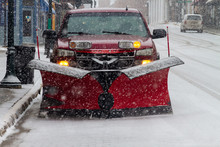 Red Truck With Red Plow On Snowy Street