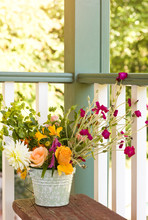 Flowers Bouquet In Bucket Pail On Front Porch. Simple, Country Style Summer Home Decor Details Elements.