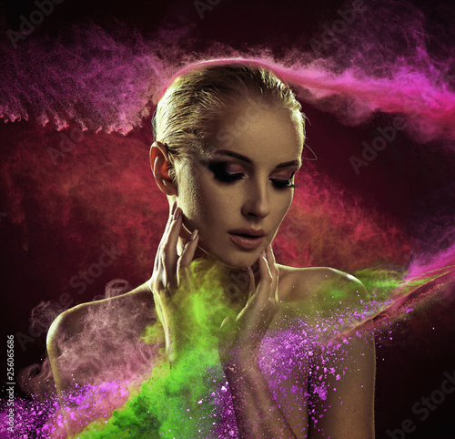 Pretty blond lady covered with colorful powder