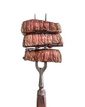 Slices Of Beef Steak On Vintage Fork Isolated On White