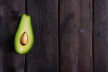 sliced avocado on a dark wooden background
