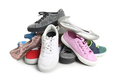 Pile Of Different Shoes On White Background