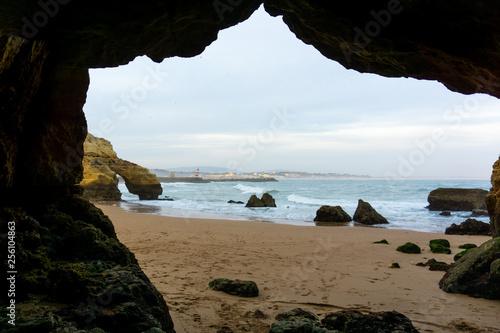 Lagos, Portugal beach scene framed by rock cave