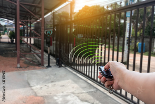 Cuadros en Lienzo Signal of remote control when person open automatic gate at house for home secur