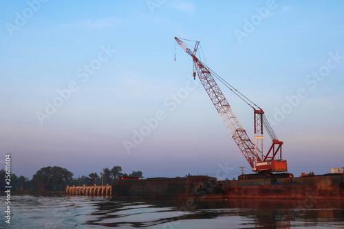 Photo Crawler cranes used for rebuilding bridges  near the river